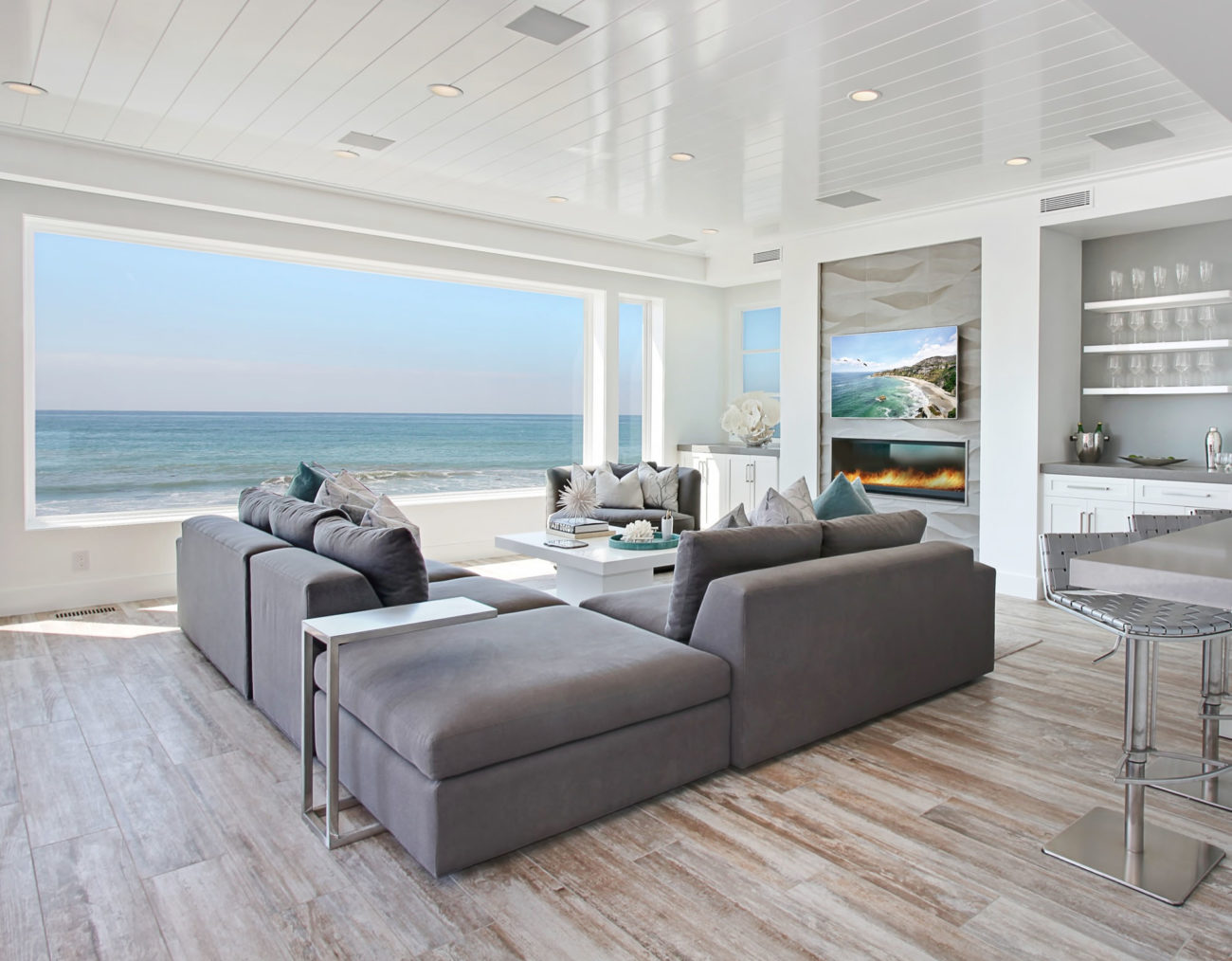 This coastal contemporary Beach retreat was designed with an open floor plan, modern finishings and west coast casual comforts. With 180 degree views of the pacific we chose to keep the ocean as the art and focus on the architectural details. This is evident in the staircase where the drywall and tiled stairs meet with […]