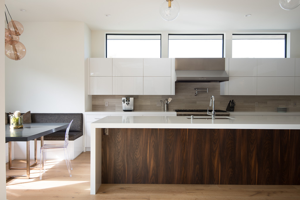 This house is ready for Carrie Bradshaw to stop by for a glass of wine. It features modern design and a funky aesthetic. Once you pass the 10 feet tall entry door, you're greeted by a large waterfall edge bar and temperature controlled wine wall. Marble islands, wide plank wood floors and a chef's kitchen […]